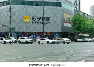 Chengdu,Sichuan/China- April 24,2019:Suning tesco stores at a busy intersection in downtown chengdu.The rise of e-commerce forces the traditional formats to live in smaller and smaller space.