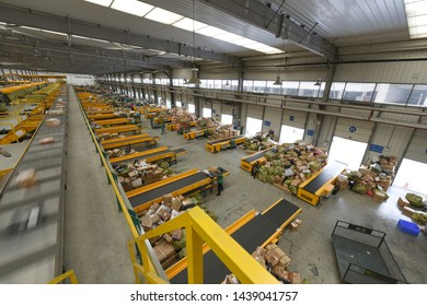 Chengdu,Sichuan/China-January 13, 2014:The sorting line of China post sorting center is running at high speed.During the Spring Festival, only the state-run China post remained open.
