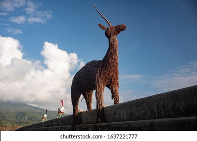 Chenggong, Taipei - December 19 2019: The deer sculpture stands at the dam at Pisirian Coast, where indigenous Amis people living.