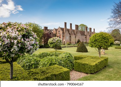 Chenies, United Kingdom, May 3rd 2017: Chenies Manor House in the Summer with a blue sky and beautiful gardens. English country house in Hertfordshire.