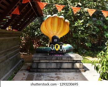 CHENKAL, TRIVANDRUM, KERALA, INDIA, JANUARY 13, 2019: Maheswaram Sri Sivaparvathi Temple with the world's tallest Shiva lingam in the background, on a bright day.