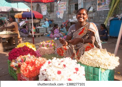 CHENNAI, INDIA 21 FEBRUARY 17 : Unidentified woman flower vendor selling flowers in the flower market, The Chennai flower market is known as largest flower market.