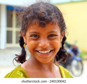 CHENNAI, INDIA - AUG 16: Unidentified hindu girl poses for a camera on August 16, 2014 in Chennai, Tamil Nadu, Southern India. Local people very like to take a picture with a foreigners.
