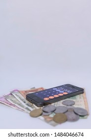 CHENNAI, INDIA - August 08, 2019: Finance concept - Mobile Phone Calculate and new Indian rupees blur on white background with space for text