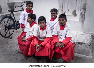 Chennai, India - August 18, 2018: Altar servers ready for the mass in the courtyard of St. Thomas Cathedral. An altar server is a lay assistant to a member of the clergy during a Christian liturgy