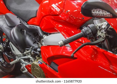 chennai india august 26 2018 side view of red colored ducati motorcycle parked.with selective focus on the subject
