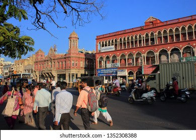 CHENNAI, INDIA -FEB 26 : People and vehicles move in front of the heritage buildings in the mount road on February 26, 2019 in Chennai, Tamil Nadu, India.
