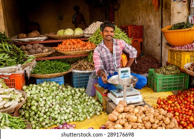 CHENNAI, INDIA - JANUARY 09, 2014: A young Indian man at his fruit and vegetable shop in a small rural village south of Chennai.