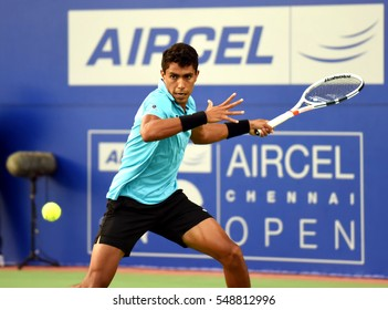 CHENNAI, INDIA - JANUARY 2, 2017: Thiago Monteiro of Brazil plays against Daniil Medvedev of Russia in the first round match at Aircel Chennai Open tournament at SDAT Tennis Stadium in Chennai.