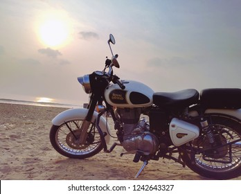 Chennai, India, january 2016: classic Royal Enfield motorbike parked in the beach at sunset