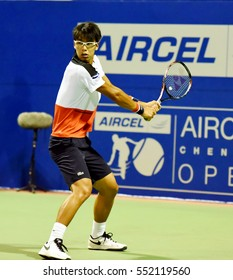 CHENNAI, INDIA - JANUARY 4, 2017: Hyeon Chung of South Korea plays against Dudi Sela of Israel in a second round match at Aircel Chennai Open tournament at SDAT Tennis Stadium in Chennai.