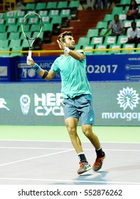 CHENNAI, INDIA - JANUARY 5, 2017: Yuki Bhambri of India plays against Benoit Paire of France in a second round match at Aircel Chennai Open tournament at SDAT Tennis Stadium in Chennai.
