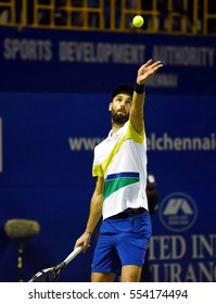 CHENNAI, INDIA - JANUARY 6, 2017: Benoit Paire of France serves against Aljaz Bedene of Great Britain in a quarter final match at Aircel Chennai Open tournament at SDAT Tennis Stadium in Chennai.