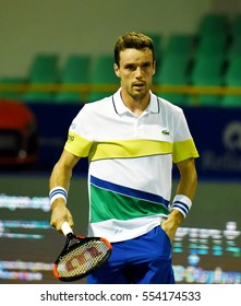 CHENNAI, INDIA - JANUARY 6, 2017: Roberto Bautista Agut of Spain plays against Mikhail Youzhny of Russia in a quarter final match at Aircel Chennai Open tournament at SDAT Tennis Stadium in Chennai.