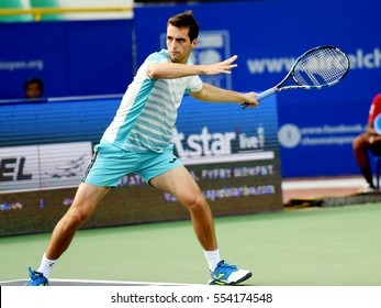 CHENNAI, INDIA - JANUARY 6, 2017: Albert Ramos-Vinolas of Spain plays against Dudi Sela of Israel in a quarter final match at Aircel Chennai Open tournament at SDAT Tennis Stadium in Chennai.