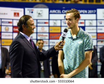 CHENNAI, INDIA - JANUARY 8, 2017: Daniil Medvedev of Russia talks with Charu Sharma during the presentation ceremony after finals of Aircel Chennai Open tournament at SDAT Tennis Stadium in Chennai.