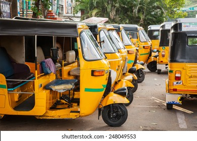 """CHENNAI, INDIA - JULY 25, 2009: Indian auto rickshaws in street. Auto rickshaws (aka  """"autos"""") provide cheap efficient transportation in many indian cities used instead of taxies for short distances"""