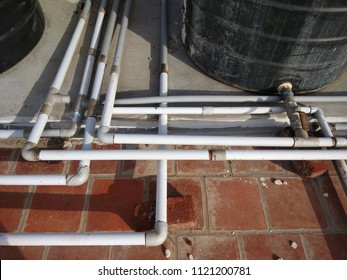 Chennai india june 24 2018 Polyvinyl chloride known as PVC water pipes connected to overhead tank forming abstract of lines or pattern seen with metal valves for closing and opening the water flow