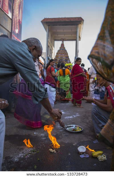 CHENNAI, INDIA - March 24: People performing their religions activity in kapaleeshwar temple car festival ( Therottam ) held on March 24, 2013 in MYLAPORE, CHENNAI, INDIA