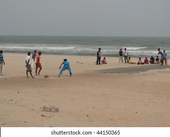 CHENNAI, INDIA - NOV 29 : Young Indian boys play cricket on the beach on Nov 29, 2009, in Chennai, India. It has been 4 years after the tsunami came ashore here.