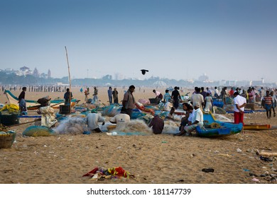 CHENNAI, INDIA-FEBRUARY 10: Fishermen on the beach Marina Beach on February 10, 2013 in Chennai, India. The beach runs from near Fort St. George in the north to Besant Nagar in the south. 13km