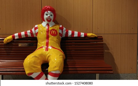 chennai mall, chennai india October 8 2019 Ronald McDonald clown sitting on a beach inside the shop, people usually seen taking selfie or group photograph with the clown.unedited low light photography