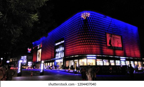 chennai mall,chennai india September 28 2018 entrance to Phoenix shopping mall illuminated with colorfully decorated lights surrounding the we exterior wall.low light photography