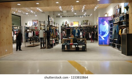 Chennai mall,Chennai,India July 22 2018:Interior view of retail outlet in a mall where people are seen shopping with their family and friends.Low light photography.