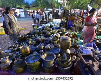 CHENNAI, TAMIL NADU, INDIA, APRIL 17, 2017: Yard sale. Sale of old brass utensils on the ground of a local exhibition cum sales event, late in the evening.