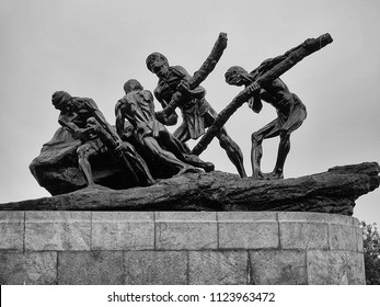 CHENNAI, TAMIL NADU, INDIA, MARCH 3, 2018: Triumph of Labor statue on the Marina beach shows four men toiling to move a rock, sculpted by Debi Prasad Roy Chowdhury.