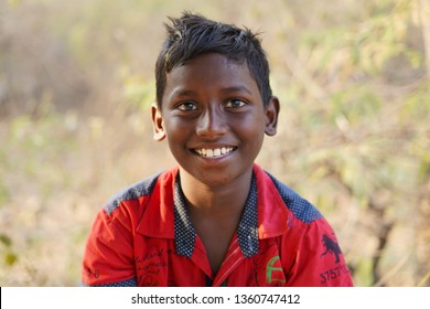 Chennai, Tamil Nadu / India - March 31 2019: Headshot of a Young Boy. Happy Indian boy smiling at camera.