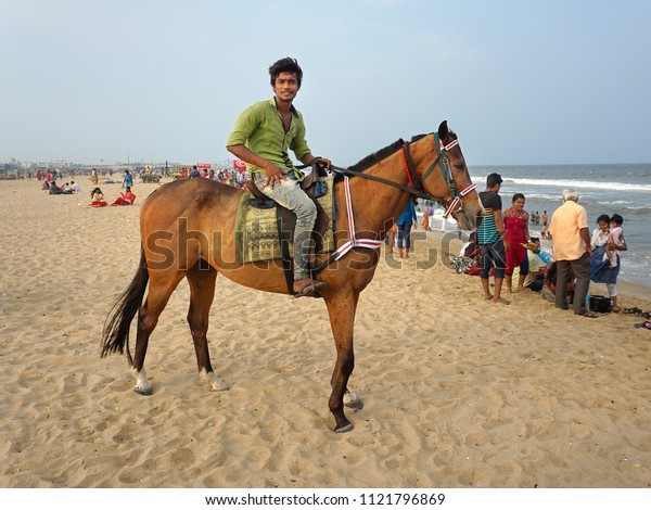 CHENNAI, TAMIL NADU, INDIA, MARCH 31, 2018:  Entertainments on the Marina Beach in the evening. Horse riding is a favorite with children. Rider on his horse.