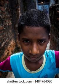 Chennai, Tamil Nadu, India - November 5th 2018 :  A serious looking boy on the streets