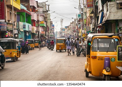Chennai, Tamil Nadu / India - October 23 2013: On the streets of Chennai (Madras). Urban buildings, scene with traffic, Indian city street full of people. Indian auto rickshaws in street.