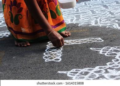 Chennai, Tamil Nadu - Jan 12th 2020 : Women drawing kolam/rangoli as part of Mylapore kolam contest