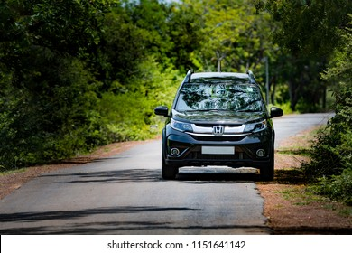 CHENNAI, TAMILNADU , INDIA - JULY 05 - 2018: Private Car, Honda BRV City Suv on country side road in the outskirts of Chennai, Tamilnadu, India.
