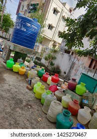 Chennai, Tamilnadu/India- 06 16 19: buckets kept in line to fill water during peak summers. all kept in line from morning