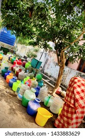 Chennai, Tamilnadu/India- 06 16 19: an old lady keeping her bucket in line for filling water in an already existing long que of buckets kept since early morning awaiting for water