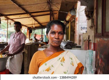 CHENNAI/INDIA - APR 20. Unidentified indian woman poses for a photo on April 20, 2019 in the kitchen at her family's cafe in Chennai, Tamil Nadu, Southern India
