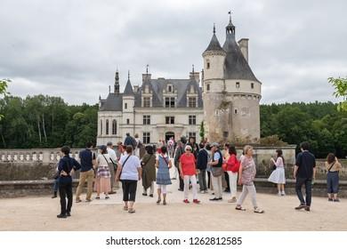 CHENONCEAU, INDRE-ET-LOIRE / FRANCE - JUNE 19, 2018: Tourists at the entrance to the Chateau de Chenonceau