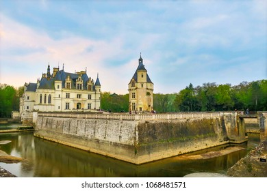 Chenonceaux, France = 4/5/2017: Moat entrance and moat wall of the Chacteau de Chenonceau situated on the River Cher in the Loire Valley. The original 15th century castle keep still stands.