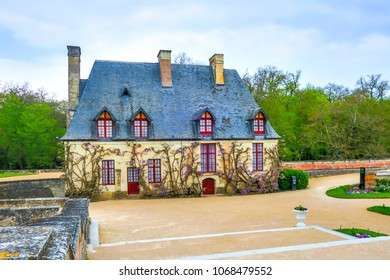 Chenonceaux, France - 4/5/2017: Wisteria vines bloomi on the Chancellery building wall inDiane de Poitier's garden at the Chateau de Chenonceau castle in the Loire Valley, France.
