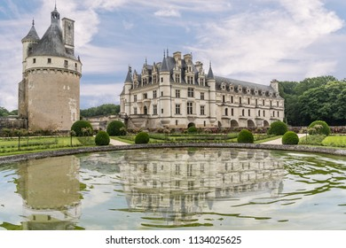CHENONCEAUX, FRANCE - June14, 2018: Historic and beautiful Château de Chenonceau and reflection in garden fountain. It is located along the River Cher located in the Loire Valley in France.