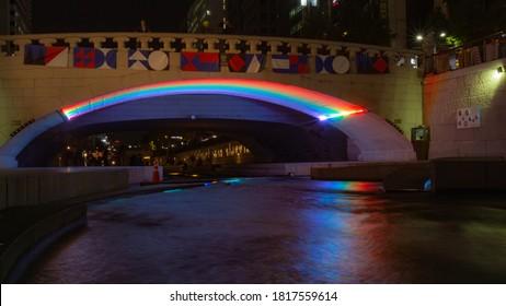The Cheonggyecheon Stream at Gwangtonggyo Bridge at night, with a rainbow reflection on the water, Seoul, South Korea