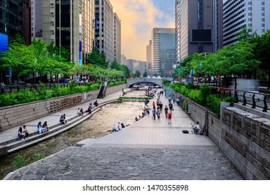 Cheonggyecheon Stream Park with Crowd in sunset time. Cheonggyecheon canal is a famous places in Seoul City, South Korea. - Shutterstock ID 1470355898