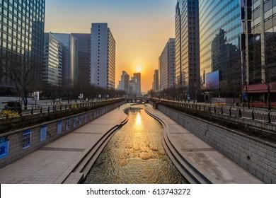 Cheonggyecheon Stream and Seoul city skyline when sunrise, Seoul, South Korea