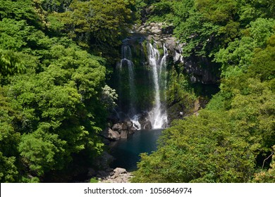 Cheonjeyeon 2nd waterfall. Cheonjeyeon is a three-tier waterfall, which is one of the most famous falls in Jeju island, Korea. The forest around the falls was designated as a Natural Monument