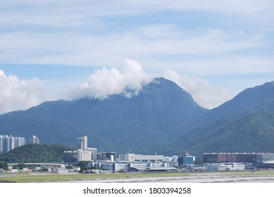 Chep Lap Kok, New Territories, Hong Kong - August 12, 2011: Cathay City and Lantau Peak covered with clouds in the afternoon.