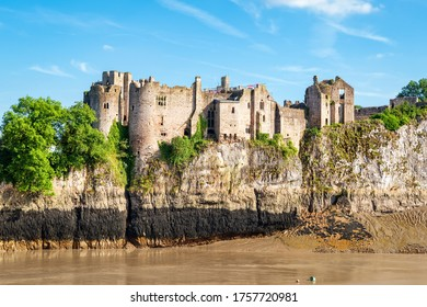 Chepstow, Wales, United Kingdom - June 14, 2017: View across river to Chepstow Castle - the oldest surviving post-Roman stone fortification in Britain, found in 1067. Copy space in sky.