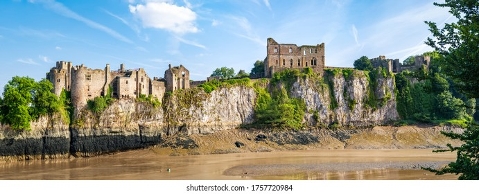 Chepstow, Wales, United Kingdom - June 14, 2017: Panoramic view across river to Chepstow Castle - the oldest surviving post-Roman stone fortification in Britain, found in 1067. Copy space in sky.